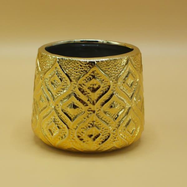 Zlatý sklenený svietnik